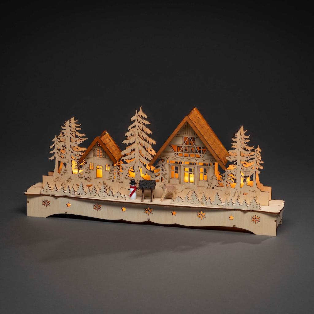 KONSTSMIDE LED Holzsilhouette, Dorf mit Schneemann und Rentier