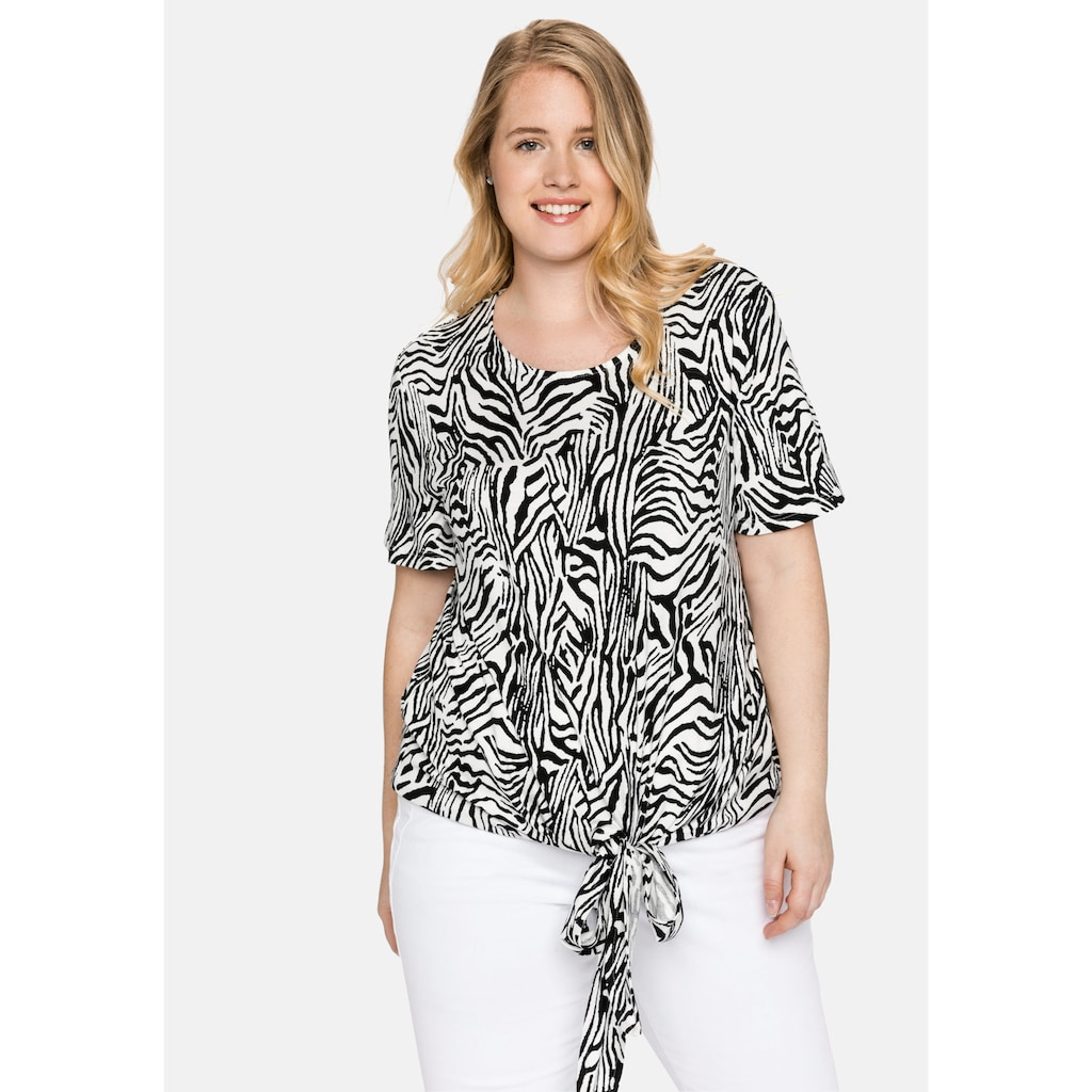 Sheego T-Shirt, mit Animalprint und geknotetem Saum