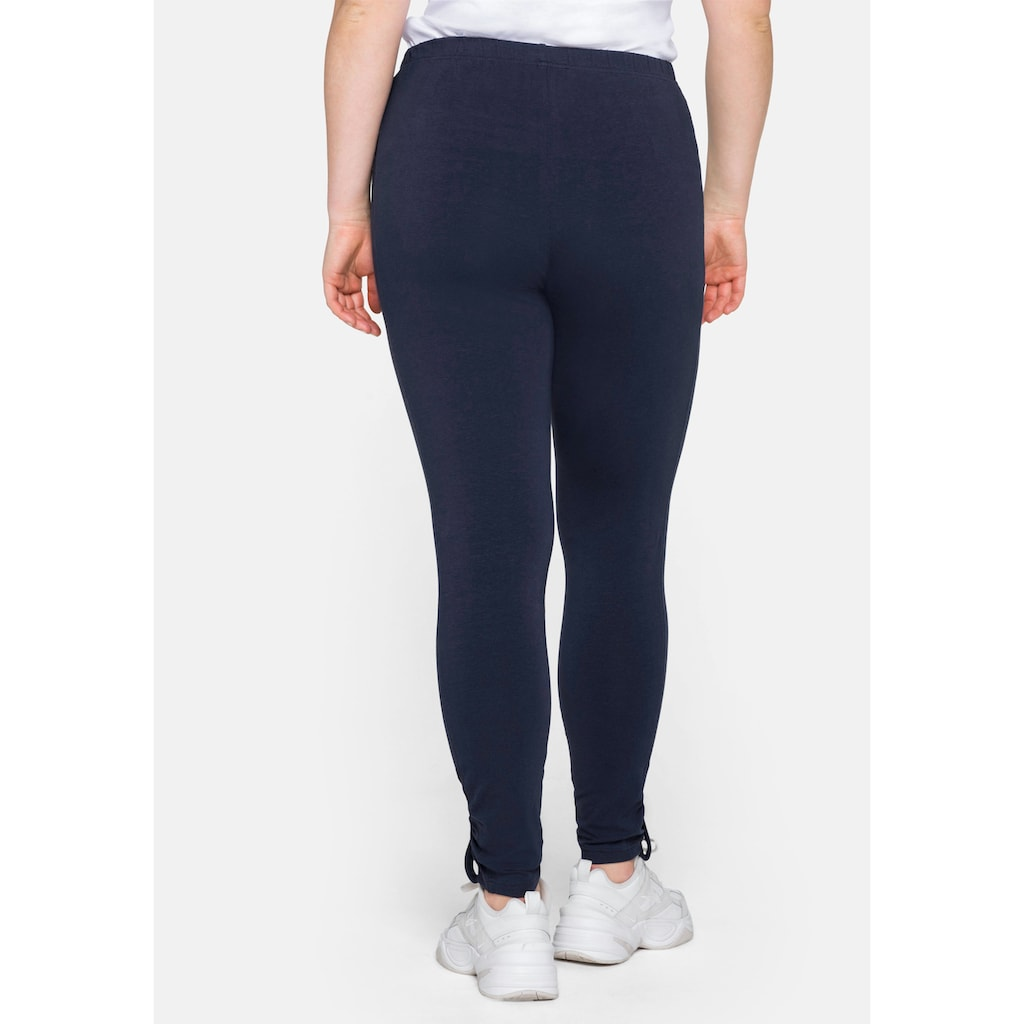 Sheego Leggings, in Ankle-Länge, mit Knopf-Detail am Saum
