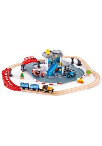 Hape Spielzeug-Eisenbahn »Notfall Hauptquartier«, mit 2 Fahrzeugen mit Licht & Sound kaufen
