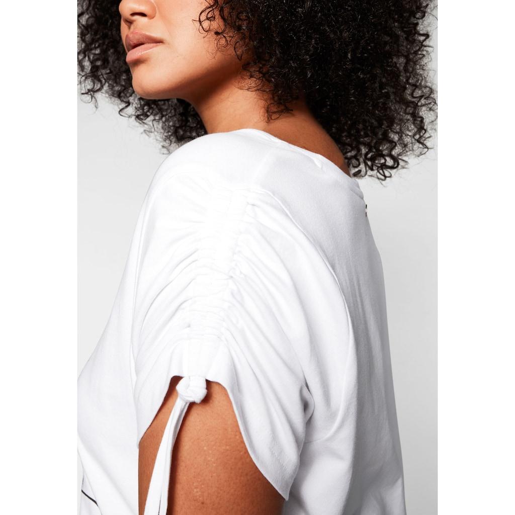 Sheego T-Shirt, mit Frontdruck und Glitzersteinen