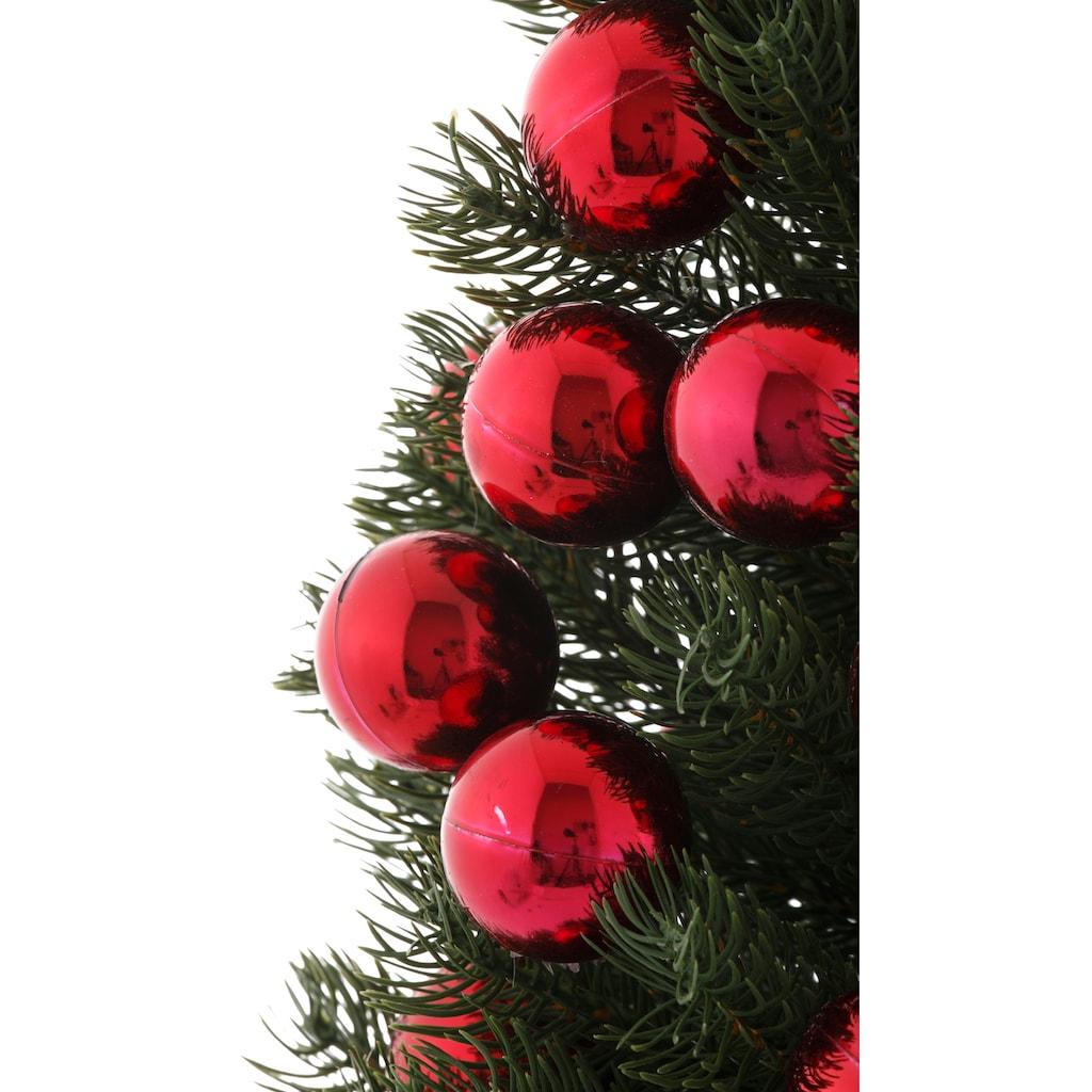 Künstlicher Weihnachtsbaum, im Topf, mit roten Kugeln