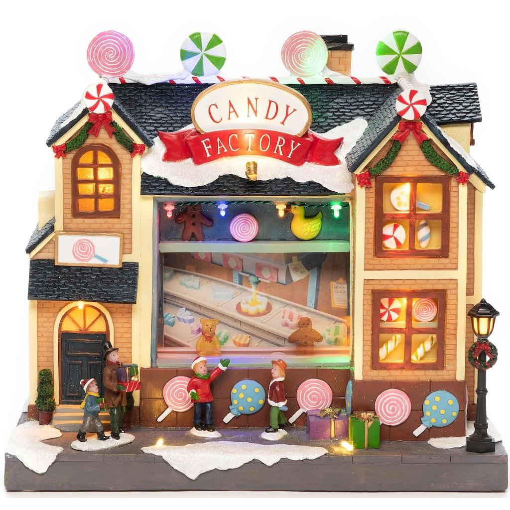 KONSTSMIDE LED Dekolicht, LED Szenerie Süßigkeitenfabrik mit Animation und 8 klassischen Weihnachtsliedern, 16 bunte Dioden, Innentrafo, schwarzes Kabel