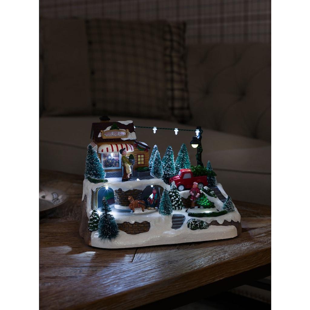 KONSTSMIDE LED Dekolicht, LED Szenerie Weihnachtsbaumverkauf mit Animation und 8 klassischen Weihnachtsliedern, für den Innenbereich, 9 kaltweiße Dioden, wählbare Energieversorgung, Innentrafo/batteriebetrieben, transparentes Kabel