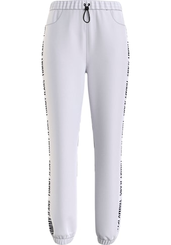 Tommy Jeans Jogginghose »TJW JOGGER TAPE RELAXED«, mit Tommy Jeans Logo-Schriftzug seitlich am Bein kaufen